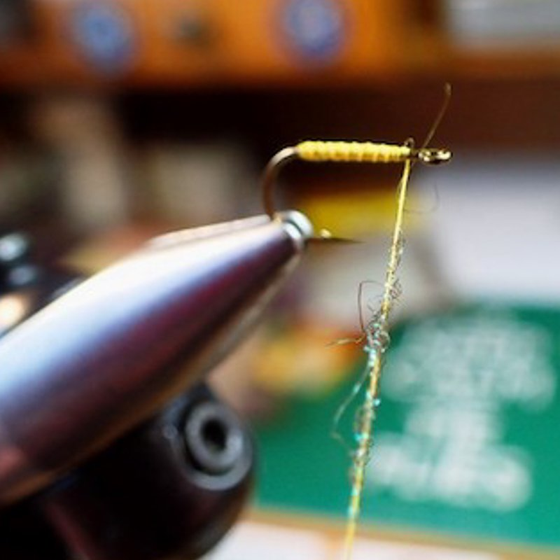6. Step 6 Take a pinch of Olive Glister and form dubbing rope